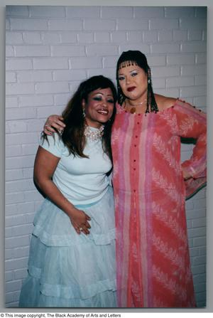 Primary view of object titled '[Miki Howard and Angela Bofill posing and hugging]'.