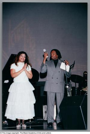 Primary view of object titled '[Miki Howard clapping and Curtis King adjusting a mic stand]'.