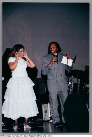 Primary view of object titled '[Curtis King & Miki Howard speaking onstage]'.
