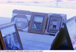 Photograph of three of James Edward Kemp's art works, Tony Dorsett Benefit, 1979