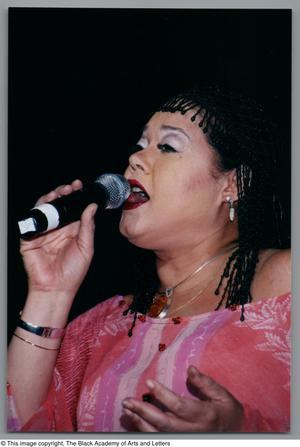 Primary view of object titled '[Close-up of Angela Bofill singing into microphone]'.