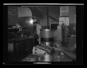 Primary view of [A cook at Ernie's Hamburger Stand]