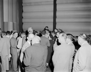Primary view of [Photograph of people engaging in conversation]