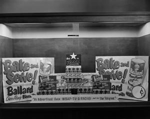 Primary view of [Photograph of Ballard Oven Ready Biscuits window display]