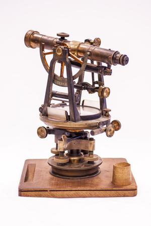 A wooden old telescope, several turning wheels at the bottom.