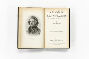 Book open to inside of introduction page. On the left page, a picture of a man with medium wavy hair and a scarf. His name is under it in small  print. On the right page the title of the book and author is there, along  with other acknowledgments.