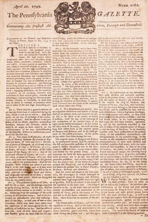 Old page of a newspaper with the title on it and a faded, black symbol on it. The majority of the page has three columns of text on it.