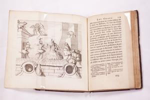 Open book. On the left side is a page with a drawing extended out. The right side of the page is full of text.