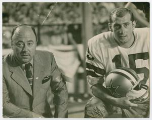 A black and white photograph of a man on the left in a suit and tie. On the right is a man in a football uniform with his helmet in his hand. The top of the photograph has a small tear on it.
