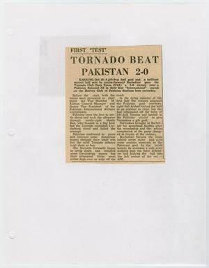 A small newspaper clipping, titled Tornado Beat Pakistan at the top in black letters, two columns of text under it.