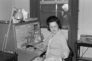 Primary view of [Photograph of an employee at a telephone switchboard]