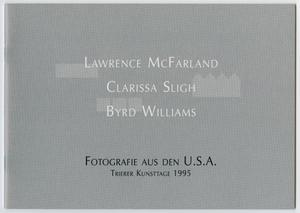 Grey catalog cover, three names in the middle of the page in white letters. On the bottom middle are the words in black letters.