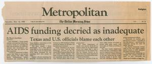 Part of a newspaper page torn off. The top of it says Metropolitan, under it is the article title with 6 short columns of text.