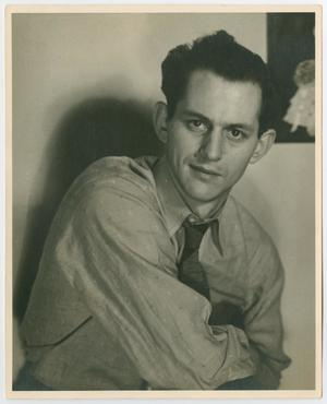 An old photo of a young man wearing a collared shirt and tie