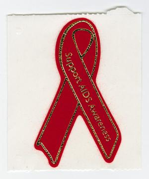 A red sticker with a gold outline in the shape of a ribbon. The ribbon has the words Support AIDS Awareness on it.
