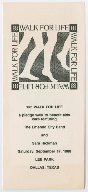 A long white booklet, the words Walk For Life at the top 4 times in the shape of a box. In the middle of that is a graphic of two sets of legs. The details for the walk are under the graphic.