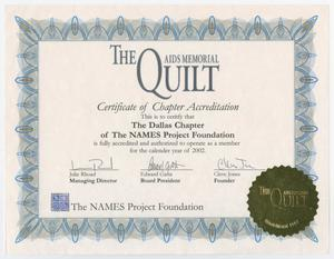 A white certificate with a blue frame design. The title of the certificate says The Quilt AIDS Memorial at the top in blue letters. In the bottom right corner is a golden sticker that says The Quilt.