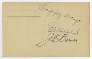 Back of a blank postcard with some handwriting on it in pen.