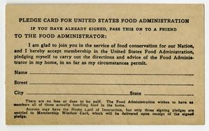 A pledge card with black text at the top. The bottom of it shows blank lines, the words Name Street and City on the left of those lines.