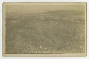 Faded black and white postcard of a faded hill.