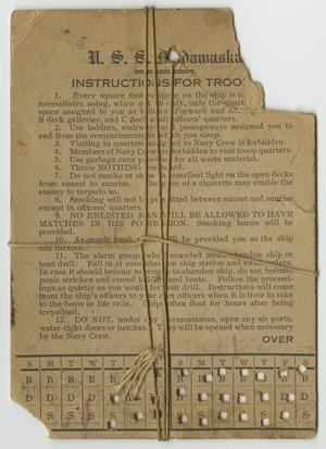 Brown card, the top right corner torn off. It is titled Instructions for Troop, with twelve numbered points, and hole punches at the bottom of it.