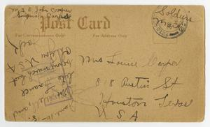 The back of a postcard with black handwriting all over it.