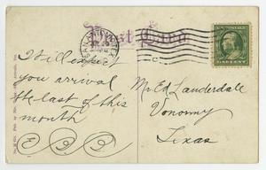 The back of a postcard, a stamp on the top right. The rest of it has writing on it in black ink.