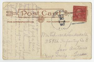 The back of a post card with a red stamp in the top right corner. There is faded handwriting all over it.