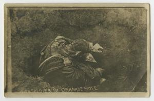 Black and white postcard of a single soldier with his face down.