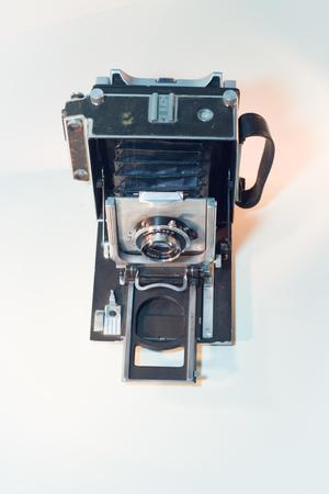 A black and silver camera. A black strap is on the right side of it.