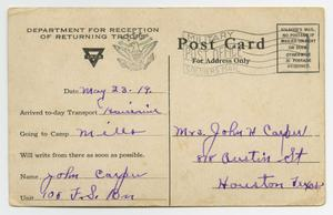 The back of a postcard. The card contains lines with blanks, purple handwriting on it.