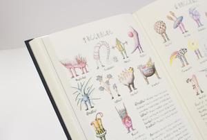 Closeup of a book page with colorful small illustration and a bit of text.