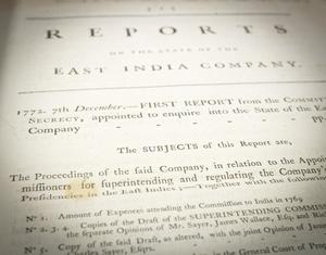 Closeup of a page titled Reports at the top, under it a subtitle that says East India Company. The photo focuses on other text on the page, the rest faded out.