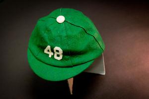 A green cap is seen from the top, a white dot at the top and a white number 48 on the front of it.