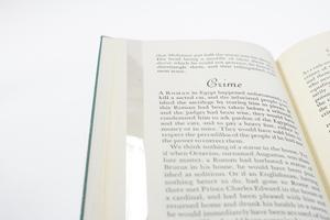 Closeup of a book page, titled Crime at the top with a small paragraph of text above it, and more text under it.