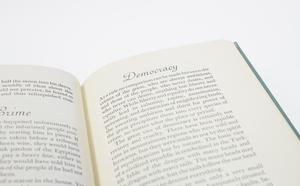 Closeup of the right page of an open book. It is titled Democracy at the top and the rest of the page is filled with text.