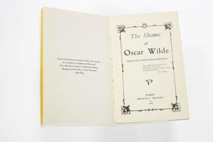 A book open, the page on the right is a title page. The page on the left contains a small bit of text in the middle.