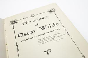 Closeup of the title page, the words in big letters. It is framed by a black line.