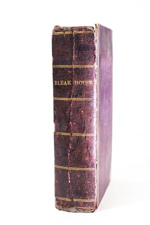 Red leather book, worn. The spine says Bleak House in gold letters.