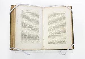 An open book, both pages are filled with text close together and wide margins.
