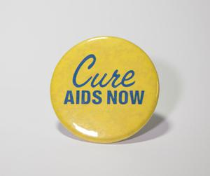 A round yellow button that says Cure AIDS NOW on it in blue letters.