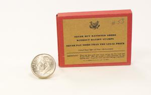 Primary view of object titled '[Consumer rationing box next to dime]'.