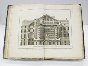 Book open to two pages, an illustration of a building with several stories expanding both pages.