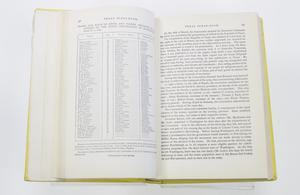 An open book with the page on the left containing an index and the page on the right filled with text in three paragraphs.