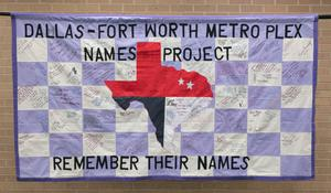 A white and light blue checkered pattern. A pattern of the state of Texas is in the middle in red, navy and white patterns. The top of the banner is black letter saying Dallas-Fort Worth Metro, and the bottom says Remember Their Names.