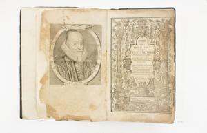 Open book, the pages old and worn. The page on the left contains a portrait painting of a man. The page on the right has the title, in the middle of an intricate design covering the whole page.