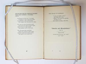 Book open to two pages, the page on the left has a poem titled On The Picture, the page on the right has a poem titled One speaks In Germany, under it is the title Swords and Ploughshares in fancy script.