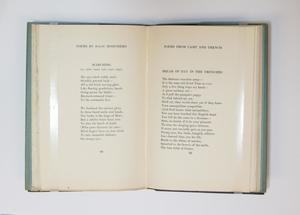 An open book, the page on the left containing a poem titled The Dying Soldier. The page on the right contains a poem titled Dead Man's Dump.