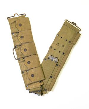 Extended thick army belt with five pockets, each with a button on it.