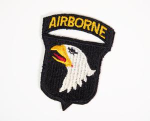 "Black sewn patch, with an eagle head sewn in the middle and the word ""Airborne"" in yellow at the top."